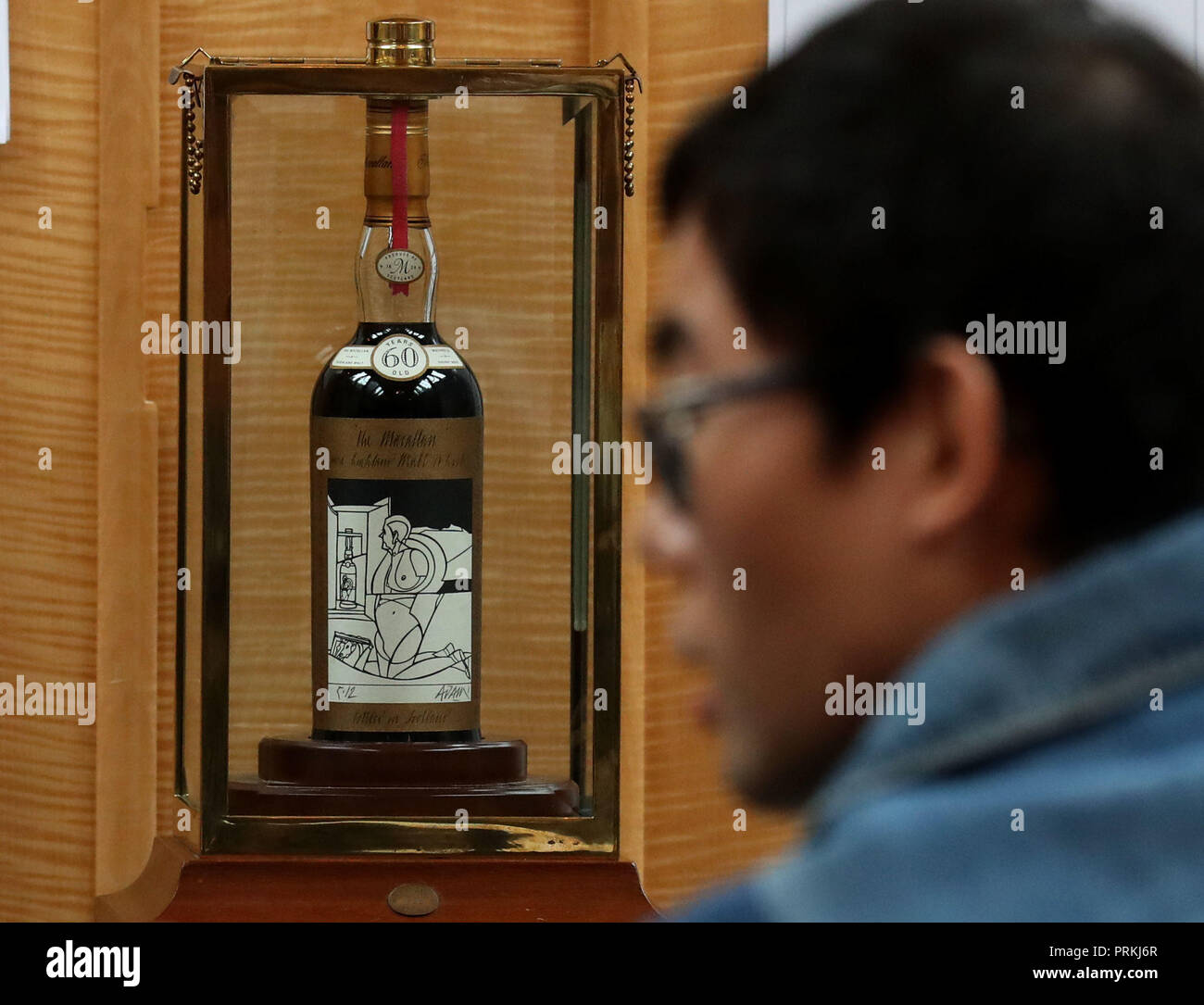 The bottle of the world's rarest and most valuable whisky, The Macallan Valerio Adami sits in the auction room ahead of it being sold for £848,750 at the Bonhams Whisky Sale at their Edinburgh auction house. - Stock Image