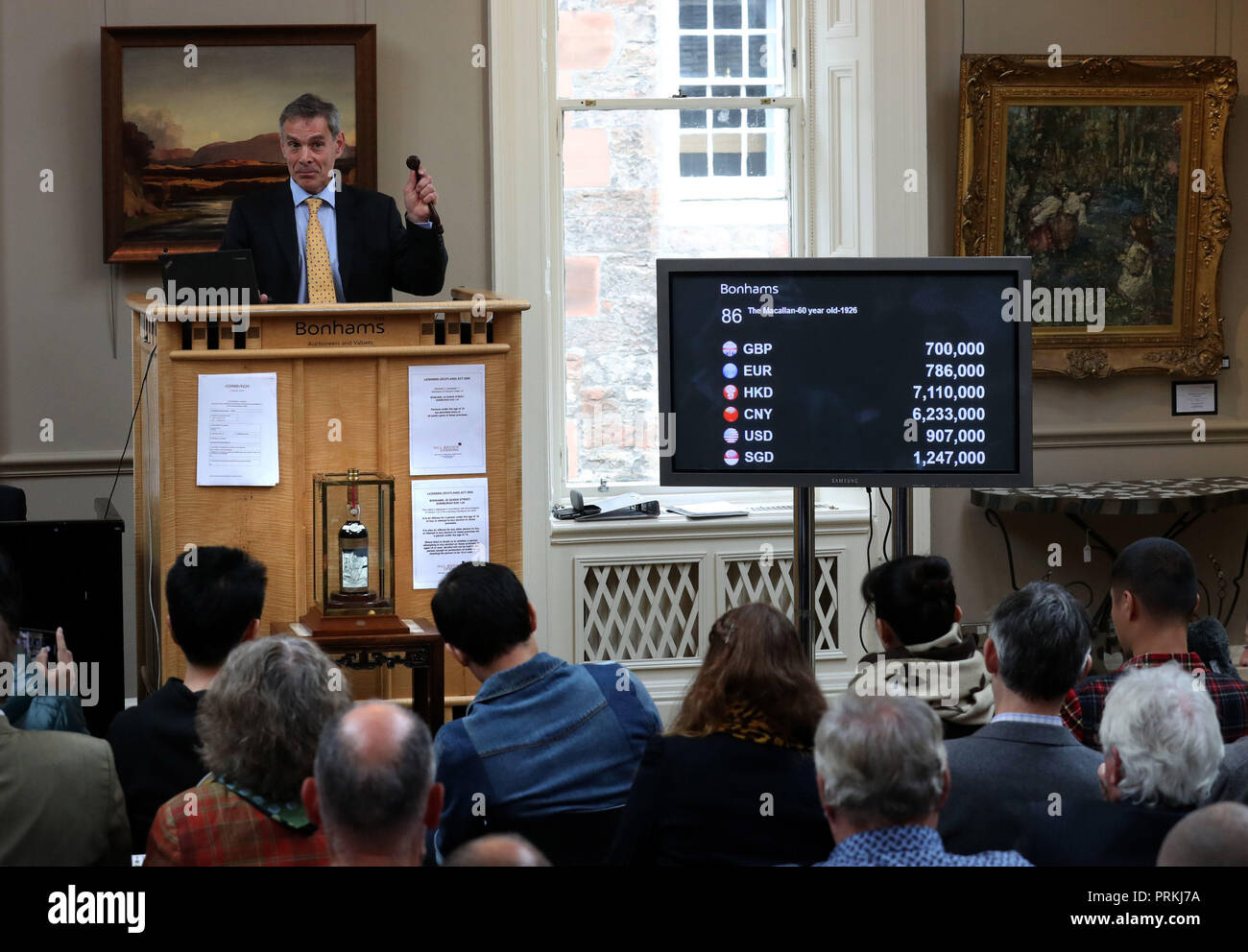 Bonhams auctioneer Charles Graham-Campbell during the auction for the bottle of the world's rarest and most valuable whisky, The Macallan Valerio Adami. It was eventually sold for £848,750 at the Bonhams Whisky Sale at their Edinburgh auction house. - Stock Image