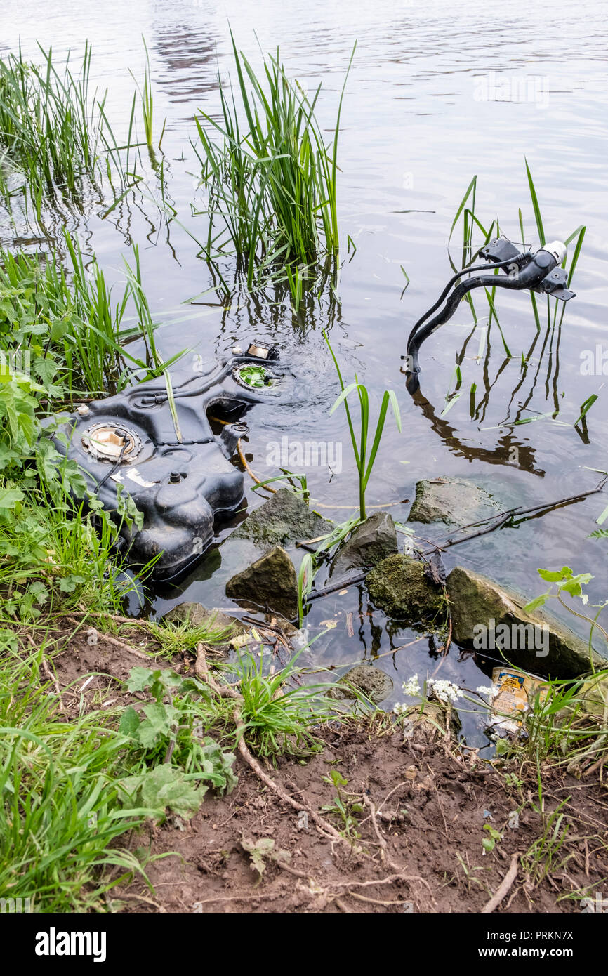 River pollution. Abandoned machinery dumped in the River Trent, Nottinghamshire, England, UK - Stock Image