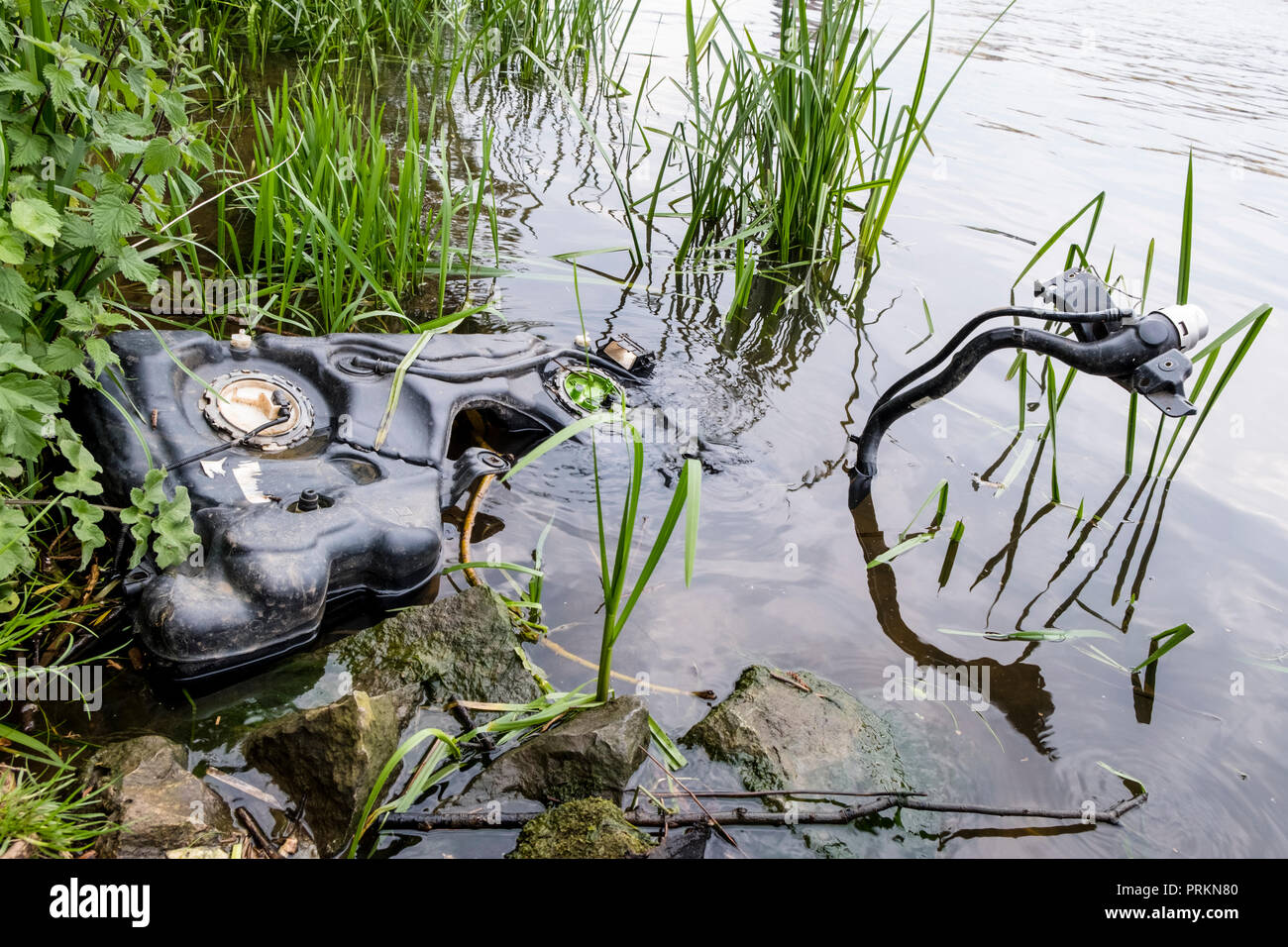 River pollution. Abandoned machinery dumped in the River Trent, Nottinghamshire, England, UK Stock Photo