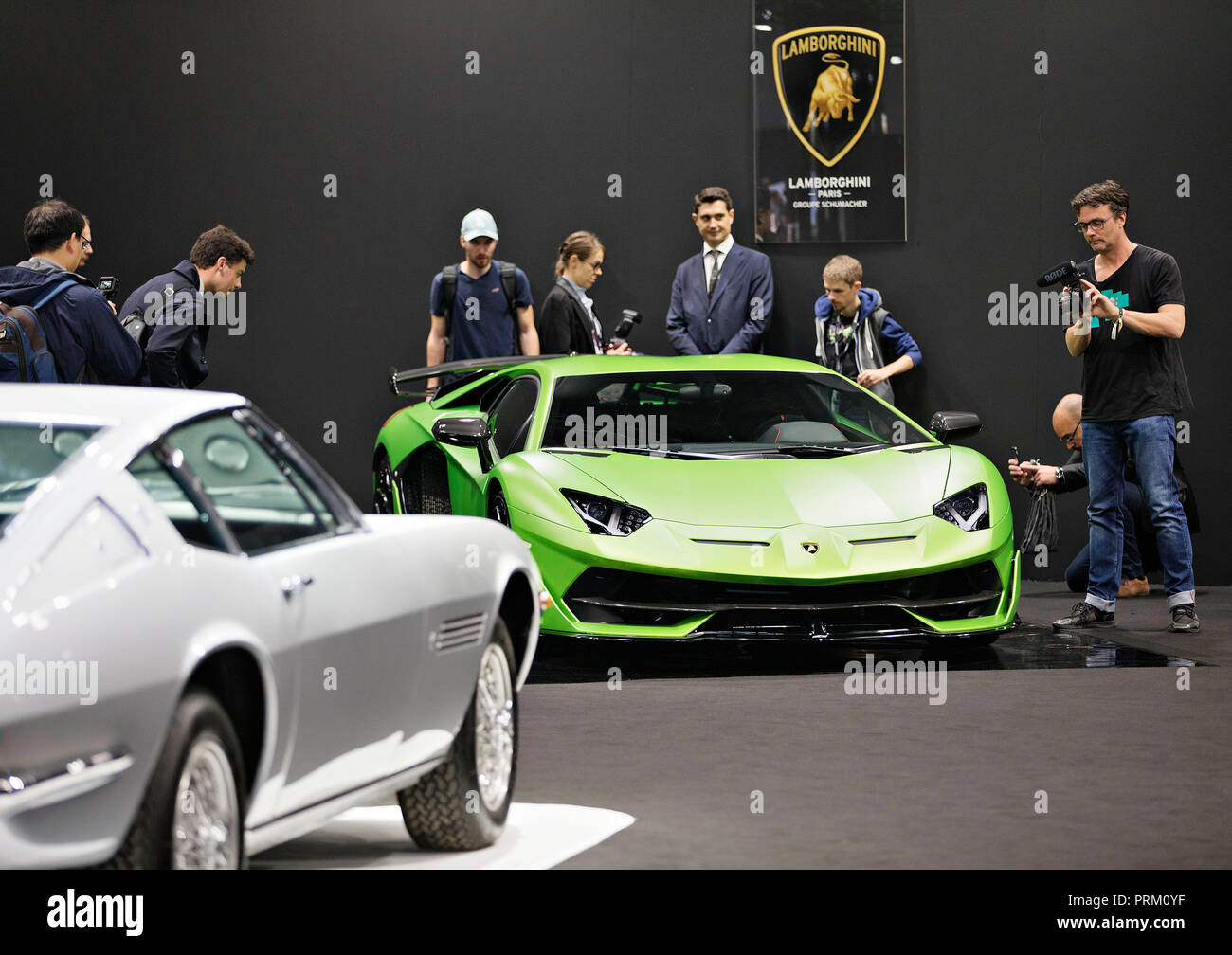 Supersport Lamborghini occupied by journalists during the second press day of the International Motor Show in Paris, France, on Wednesday, October 3rd - Stock Image