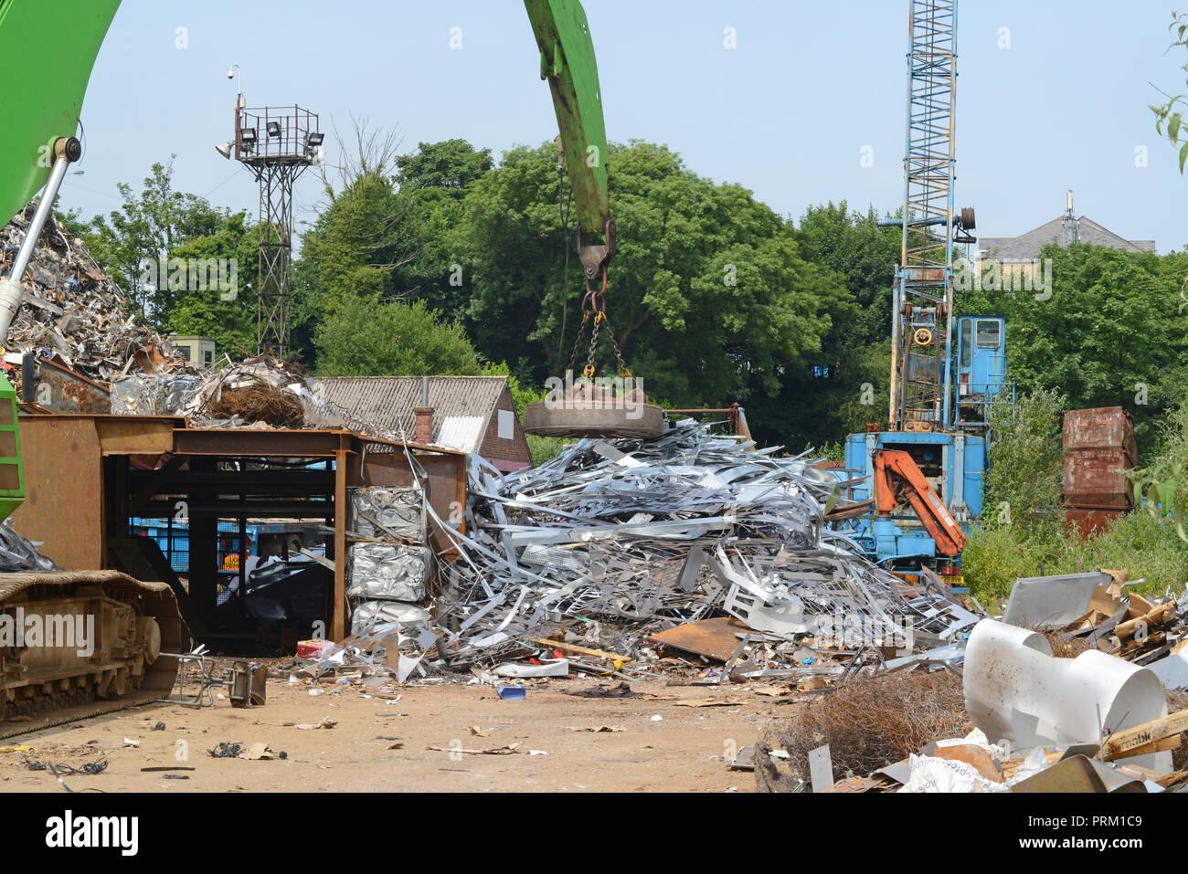 electomagnetic on crane sorting through scrap metal at scrapyard leeds yorkshire united kingdom - Stock Image