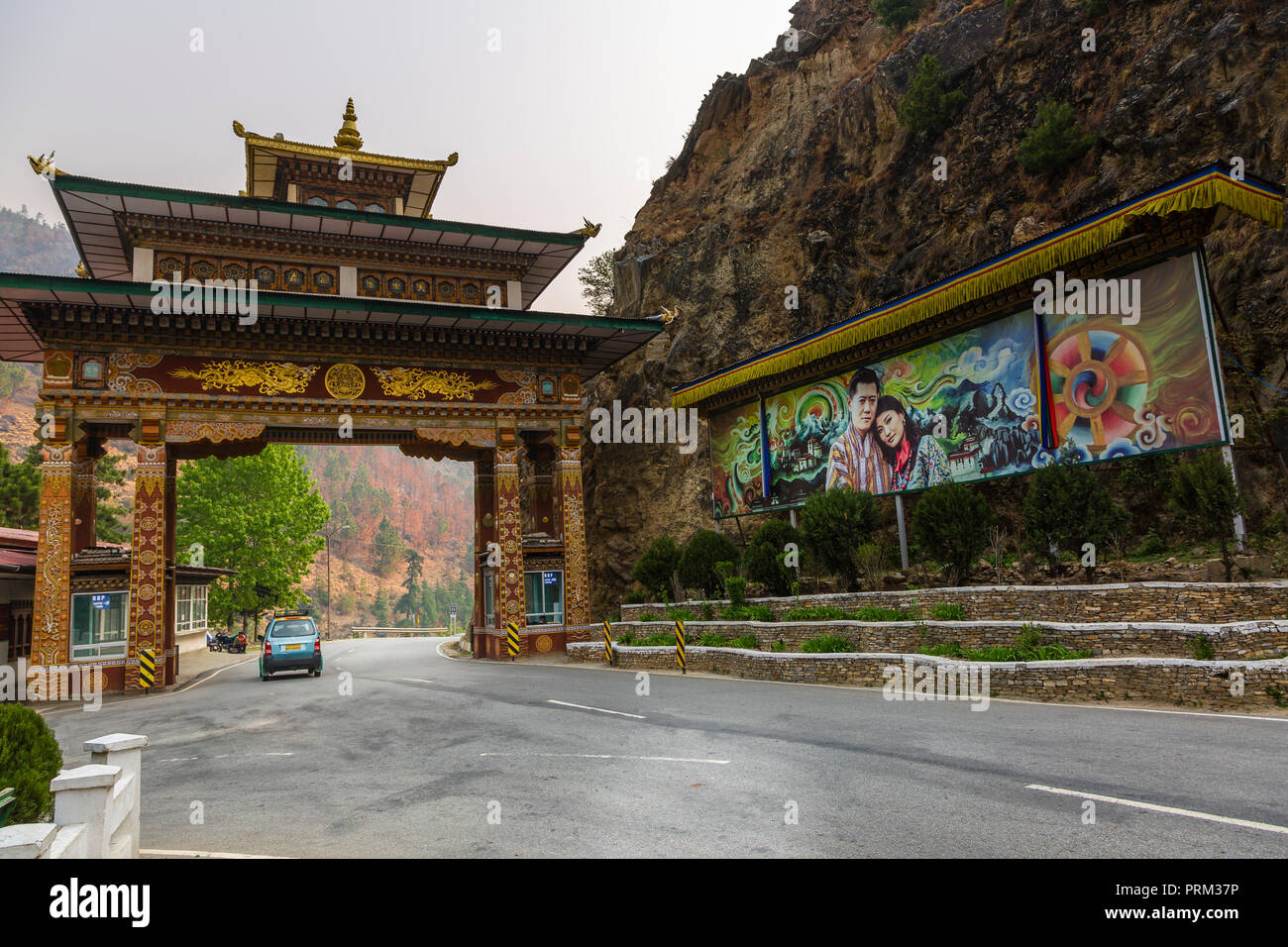 A colourful gate on a highway road in Bhutan - Stock Image