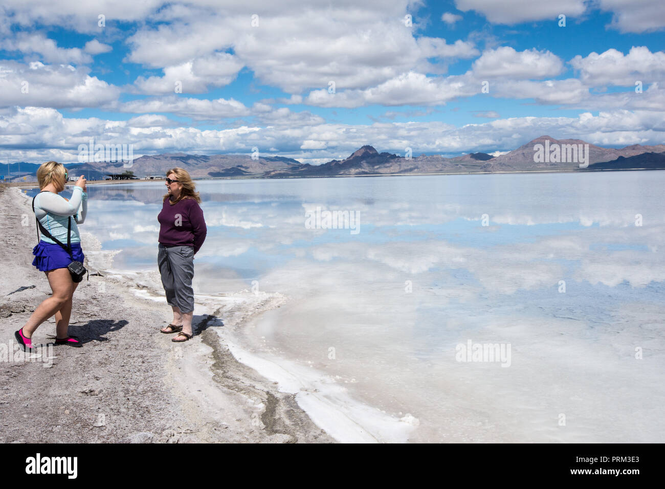 Daughter takes photos of her mother at the Bonneville Salt Flats in Utah Stock Photo