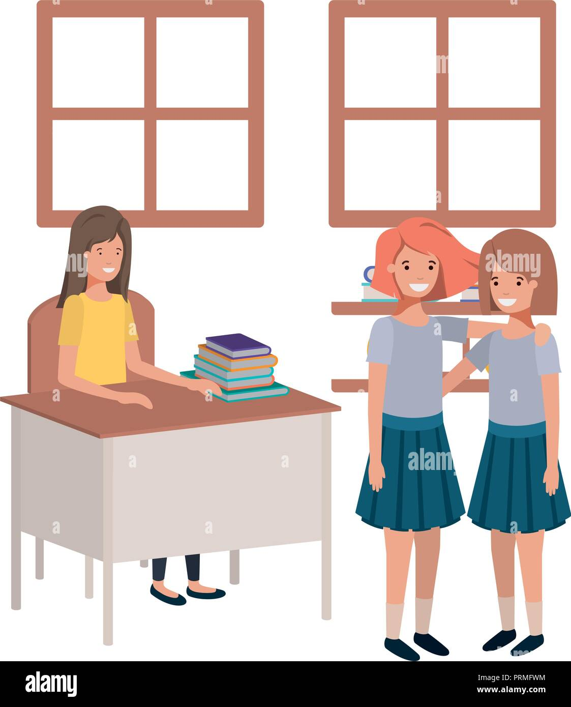 teacher in the classroom with students - Stock Image
