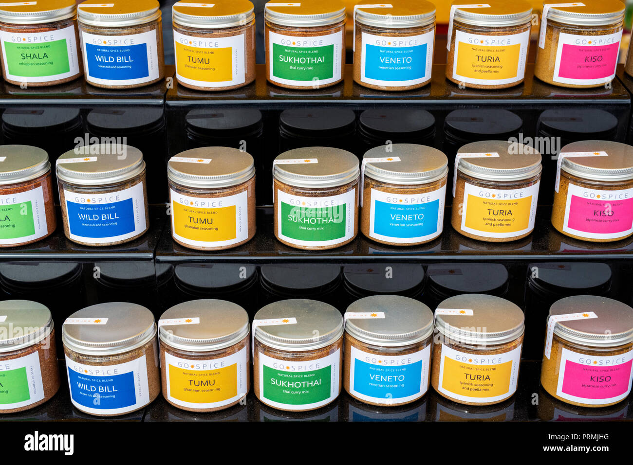 Artisan blended spice jars on a stall at the Thame food festival. Thame, Oxfordshire, England - Stock Image