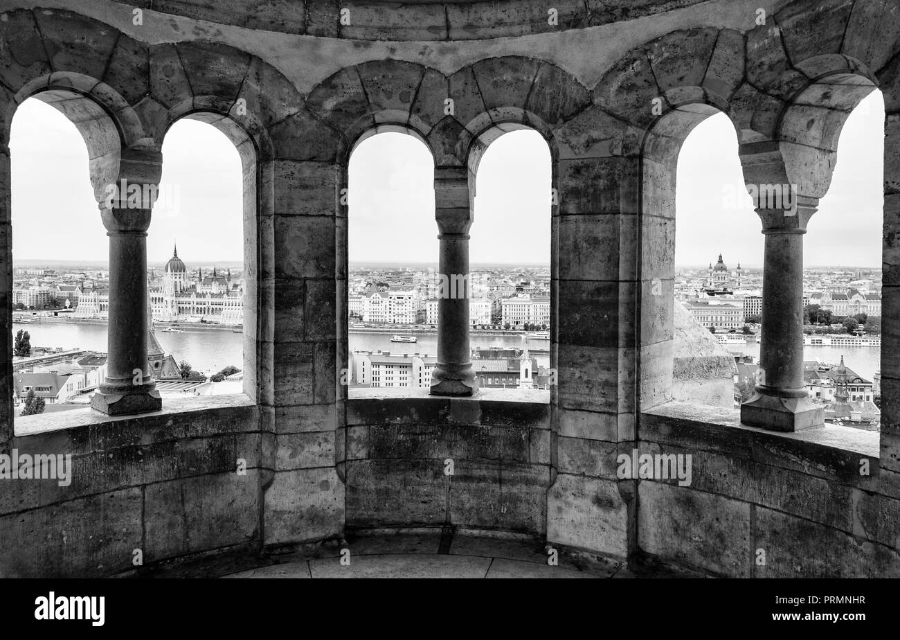 Views towards Danube and Hungarian Parliament from the arches of Fisherman's Bastion, Budapest, Hungary - Stock Image