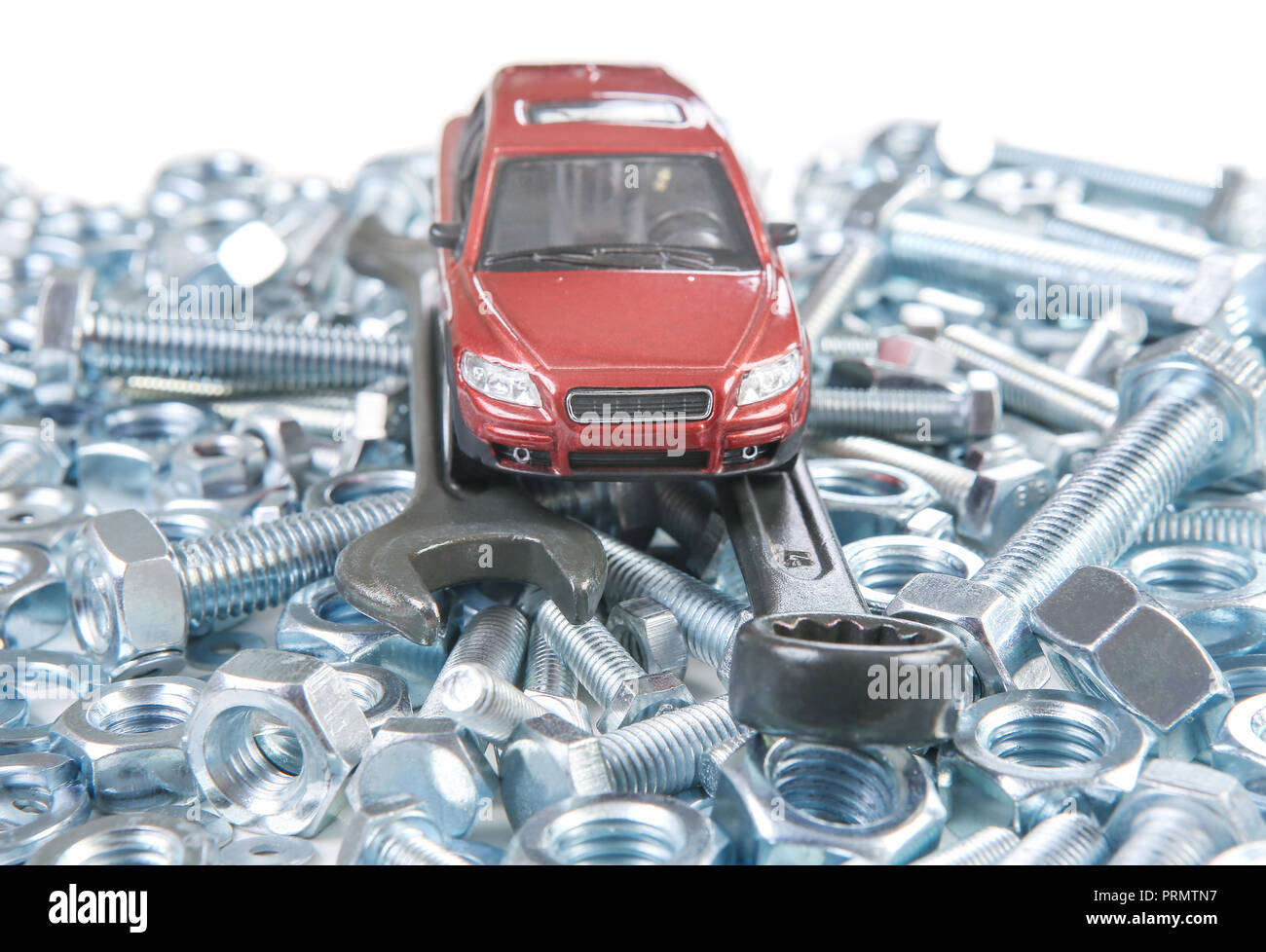 Red Toy Car On Wrenches Bolts And Nuts Stock Photo 221119955 Alamy