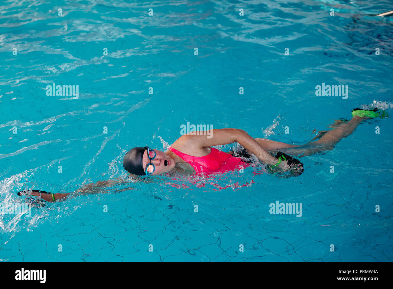 Swimming swimmer freestyle female stock photos swimming - How to make swimming pool water blue ...