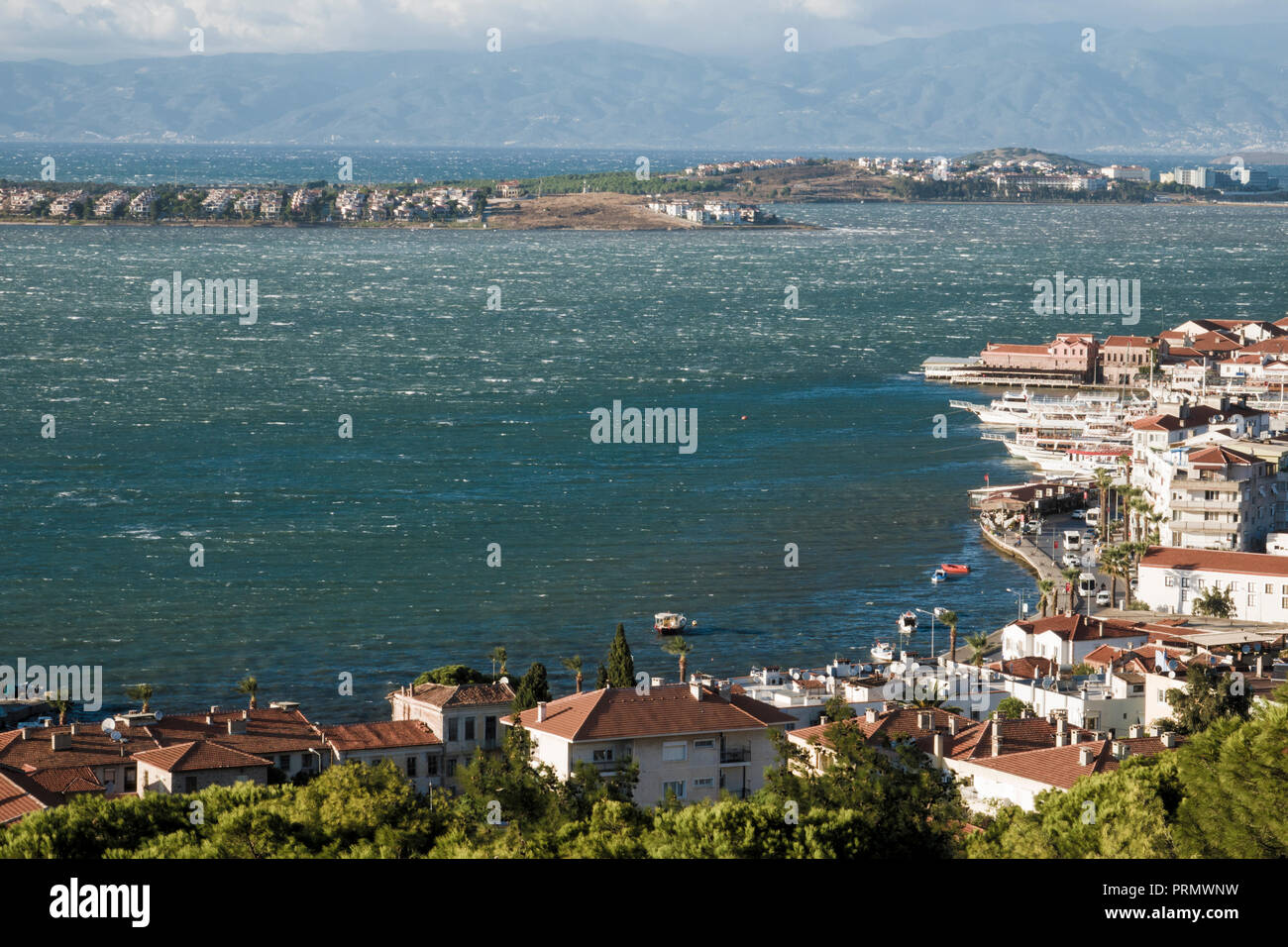 Strong winds blowing in the scenic coastal town of Ayvalik, Turkey - Stock Image