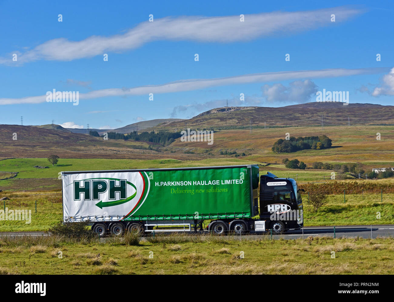 H. Parkinson Haulage Limited HGV. Delivering new solutions . M6 Northbound carriageway, Shap, Cumbria, England, United Kingdom, Europe. - Stock Image
