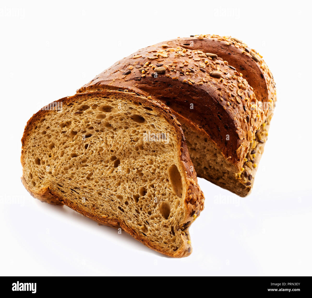 Top view of sliced wholegrain bread isolated over white background - Stock Image