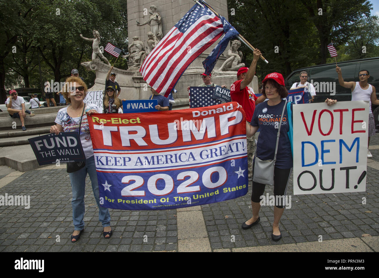 President Donald Trump supporters demonstrate at Columbus Cirlce by Central Park near the Trump Hotel in Manhattan, New York City. - Stock Image