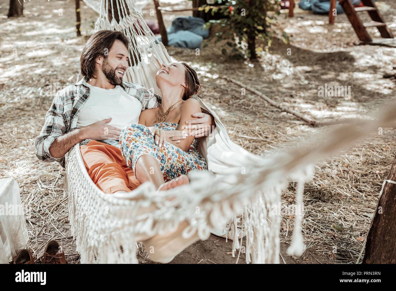 Beautiful couple spending time together in a hammock - Stock Image