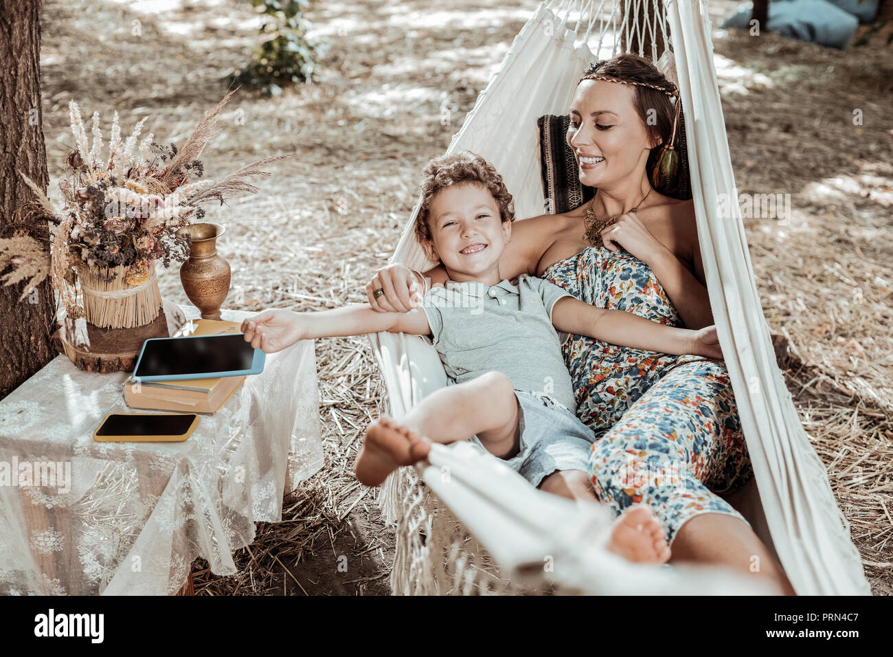 Sweet nice child resting with his mom - Stock Image