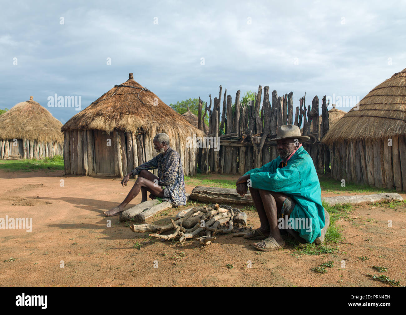 Old mwila men dressed in a western way in a village, Huila Province, Chibia, Angola Stock Photo