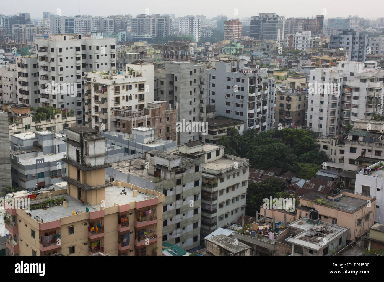 Dhaka, Bangladesh. 3rd Oct, 2018. DHAKA, BANGLADESH - OCTOBER 03 : A child riding on bicycle at the rooftop of a building in Dhaka, Bangladesh on October 03, 2018.Dhaka is the main hub of economic activity in the country Bangladesh, generating a fifth of national GDP and nearly half of all formal jobs. Credit: Zakir Hossain Chowdhury/ZUMA Wire/Alamy Live News - Stock Image