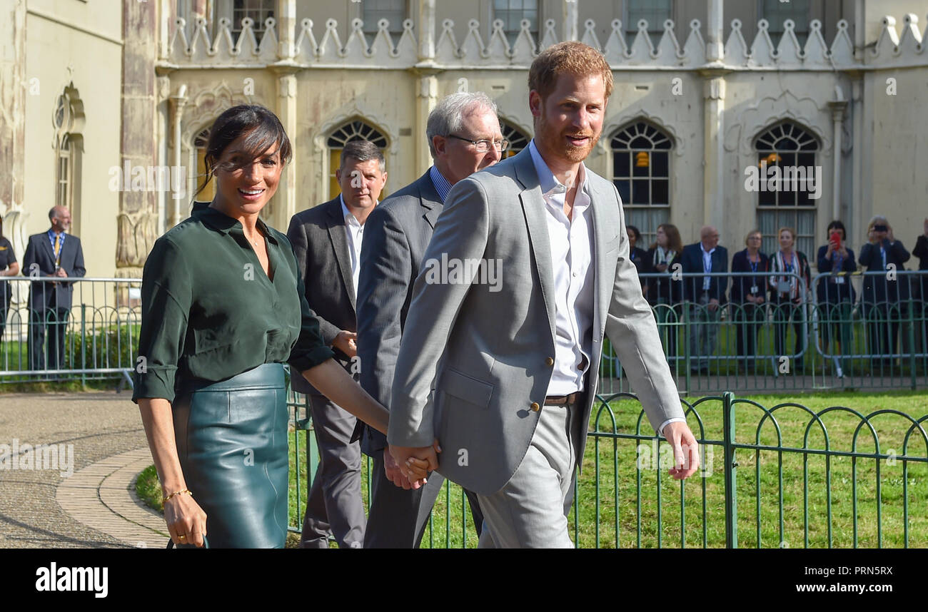 Brighton UK 3rd October 2018 - The breeze blows the Duchess of Sussex's fringe across her face as she holds  hands with the Duke of Sussex after visiting the Royal Pavilion in Brighton today as part of their first visit to the county where they have been to Chichester and Bognor as well as Brighton . Since then it has been announced the Duchess is expecting . Credit: Simon Dack/Alamy Live News Stock Photo