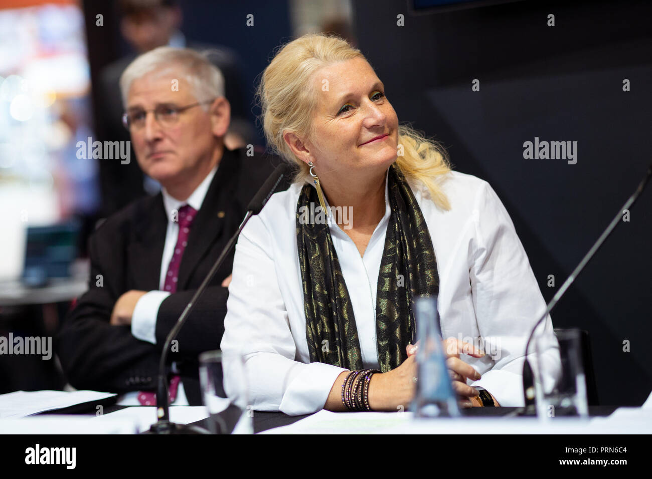 03 October 2018, Bremen: Hansjörg Dittus (l), Member of the Executive Board of the German Aerospace Center (DLR) and Pascale Ehrenfreund, Chairman of the Executive Board of the German Aerospace Center (DLR), sit at the 69th International Astronautical Congress IAC at the press conference on the landing of the lander 'Mascot' on the asteroid Ryugu. The 'Hayabusa2' probe of the Japanese space agency JAXA has brought the lander to the asteroid. The German Aerospace Center has developed and built 'Mascot' in collaboration with the French Space Agency CNES. Photo: Mohssen Assanimoghaddam/dpa - Stock Image