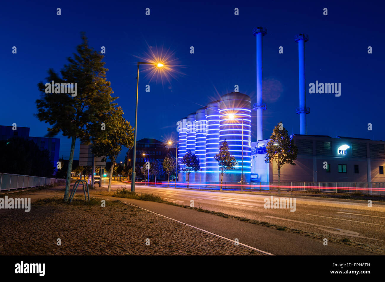 03 October 2018, Berlin: LED rings illuminate the water tanks of the Adlershof combined heat and power plant of RWE subsidiary BTB in the blue hour. (Long exposure time shooting) Photo: Arne Immanuel Bänsch/dpa - Stock Image