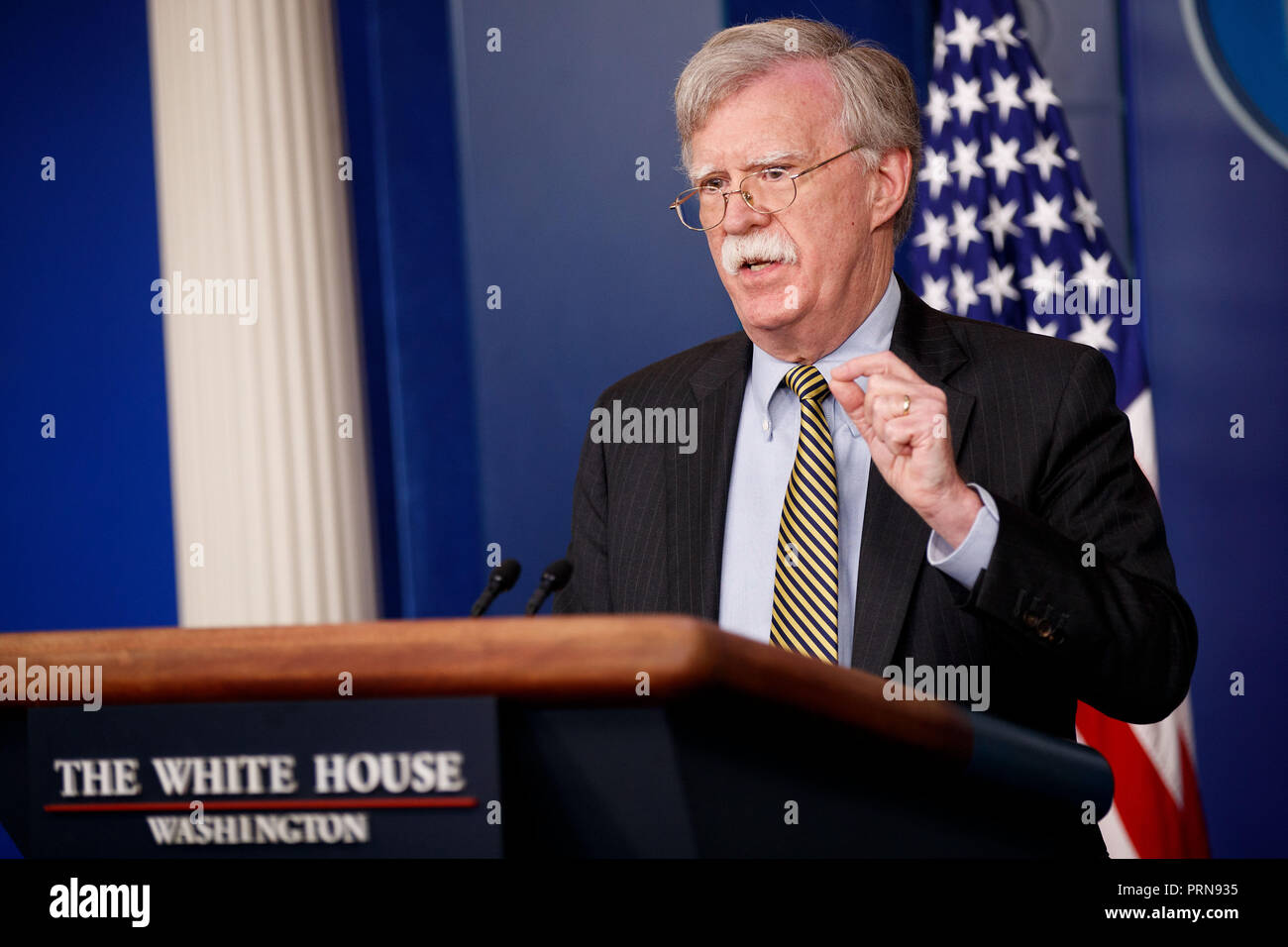 Washington, USA. 3rd Oct, 2018. U.S. National Security Adviser John Bolton speaks at a press briefing at the White House in Washington, DC, the United States, on Oct. 3, 2018. John Bolton said here on Wednesday that the United States is withdrawing from the Optional Protocol to the Vienna Convention on dispute resolution. Credit: Ting Shen/Xinhua/Alamy Live News - Stock Image