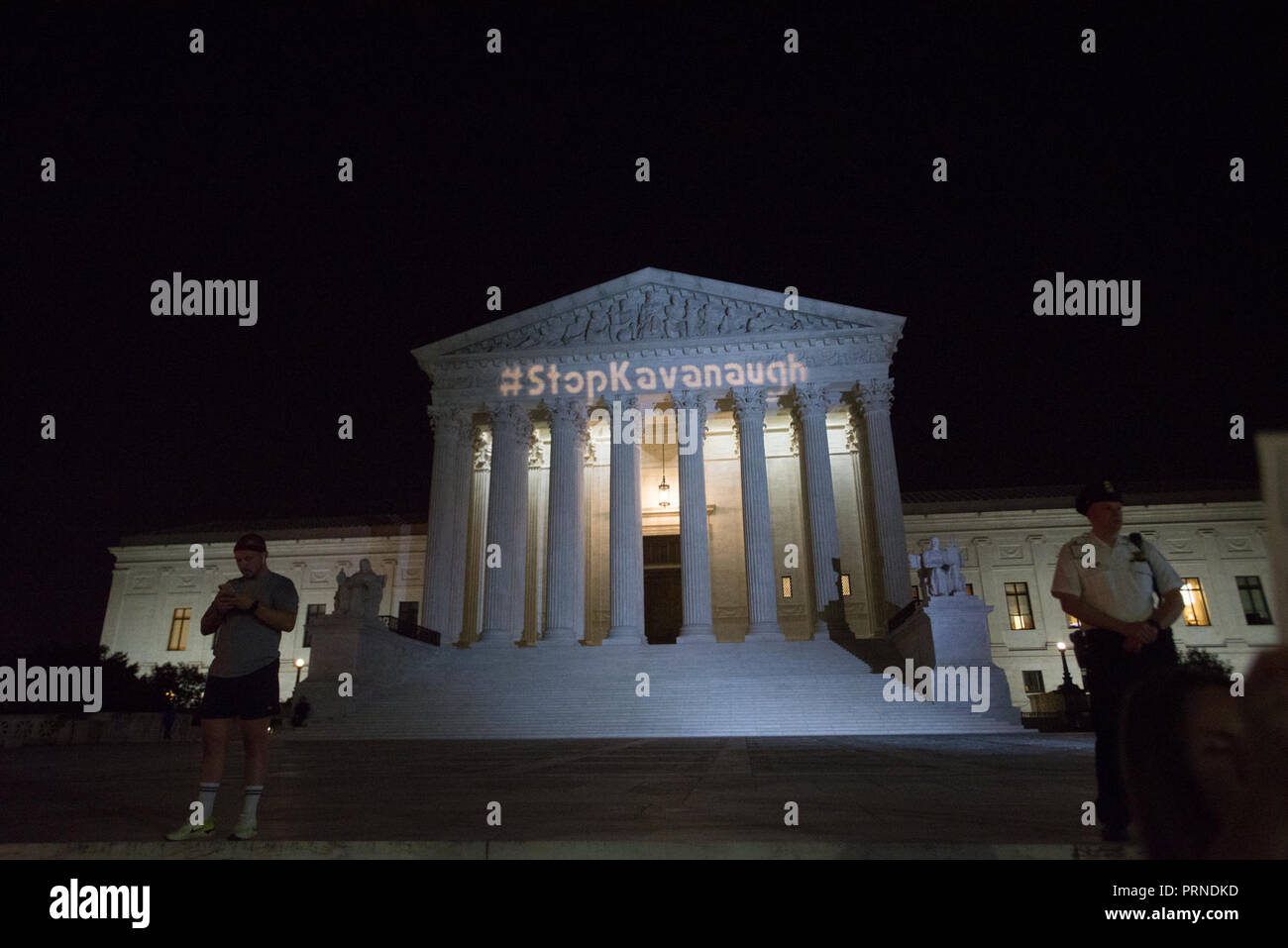 Washington DC, USA. October 3, 2018 - Stop Kavanaugh Rally at US Supreme Court.A light projection briefly shows ''#StopKavanaugh'' on the ediface of the US Supreme Court. It was quickly shut down by police. Zach D Roberts.Washington DC.USA.NEW.20181004 (Credit Image: © Zach RobertsZUMA Wire) Credit: ZUMA Press, Inc./Alamy Live News - Stock Image