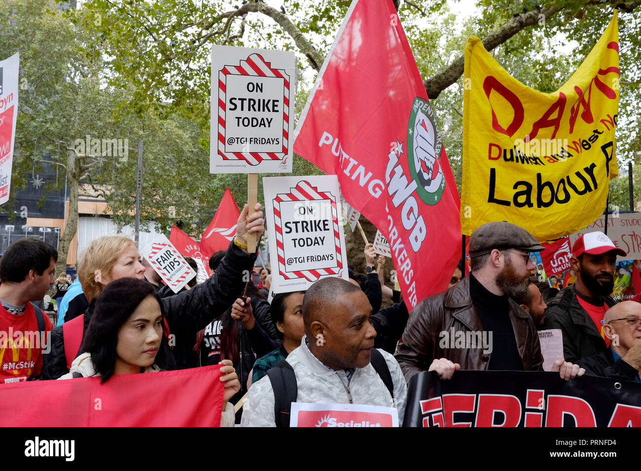 London, UK, 4th October 2018. McDonald's, wetherspoons, TGI Fridays alongside Delivroo and Uber eats riders rally in Leicester Square, demanding better working conditions, and £10 an hour. Credit: Yanice Idir / Alamy Live News Stock Photo