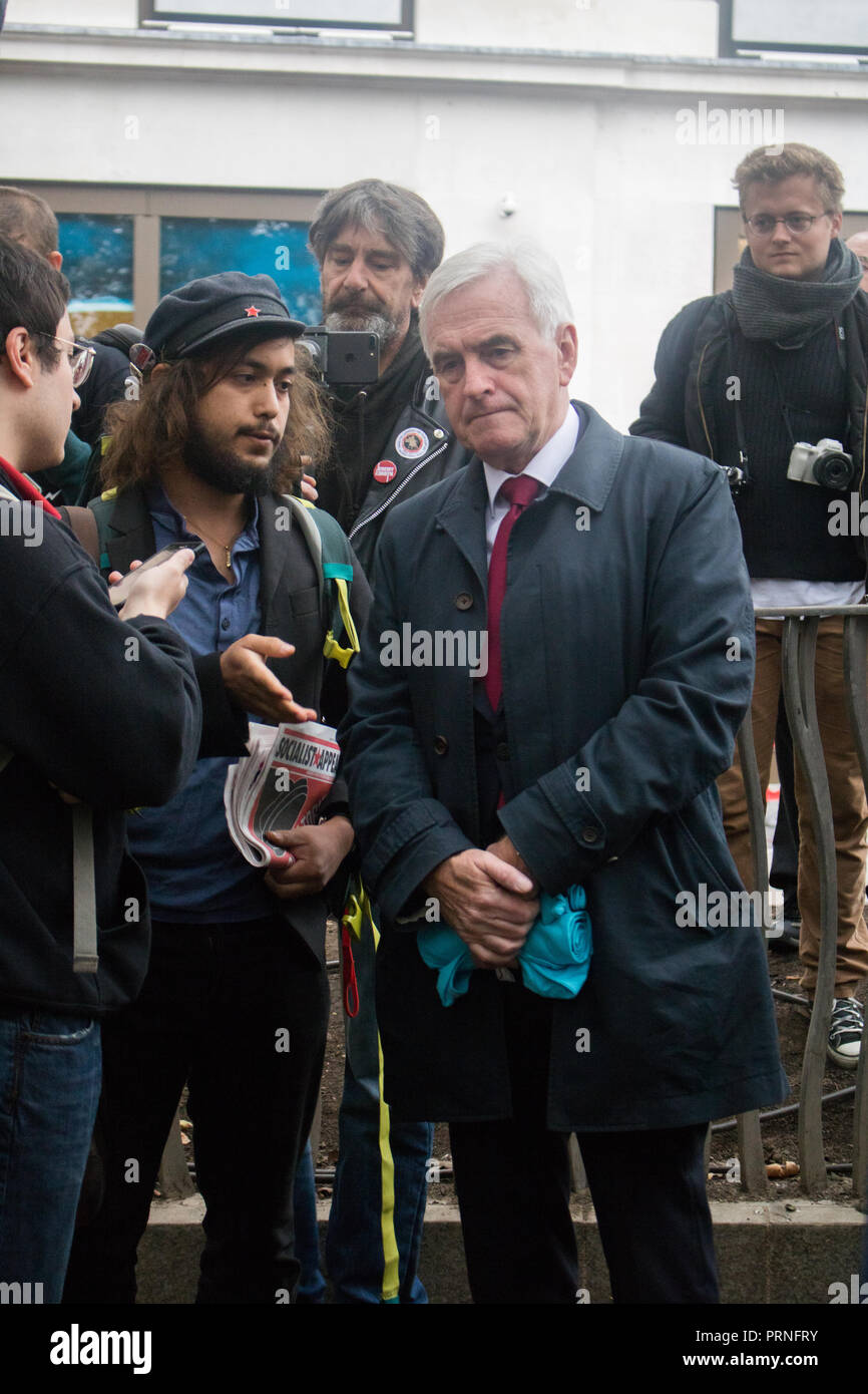 London, UK. 4th October, 2018. Labour Shadow chancellor John McDonnell joins Staff Workers from McDonald's, JD Wetherspoon and TGI Fridays and UberEats riders took part in a strike in Leicester Square over pay campaigning for £10 an hour and an end to Zero Hour contracts Credit: amer ghazzal/Alamy Live News Stock Photo