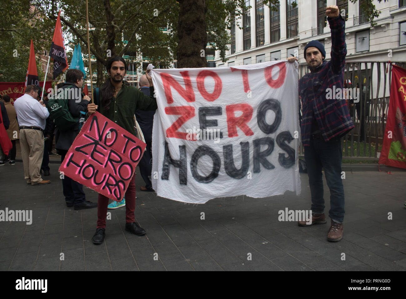 London, UK. 4th October, 2018. Staff Workers from McDonald's, JD Wetherspoon and TGI Fridays and UberEats riders took part in a strike in Leicester Square over pay campaigning for £10 an hou,  an end to Zero Hour contracts and fairer tips Credit: amer ghazzal/Alamy Live News - Stock Image