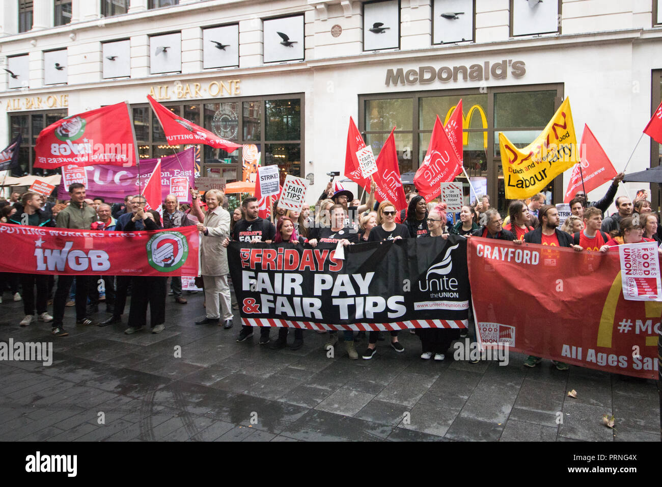 London UK 4th October 2018. Staff Workers from McDonald's, JD Wetherspoon and TGI Fridays and UberEats riders organized by Unite Union  took part in a strike in Leicester Square  to  campaign for higher wages and to be paid  £10 an hour and an end to Zero Hour contracts Credit: amer ghazzal/Alamy Live News - Stock Image