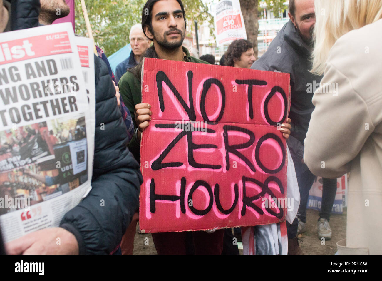 London UK 4th October 2018. Staff Workers from McDonald's, JD Wetherspoon and TGI Fridays and UberEats riders organized by Unite Union  took part in a strike in Leicester Square  to  campaign for higher wages and to be paid  £10 an hour and an end to Zero Hour contracts Credit: amer ghazzal/Alamy Live News Stock Photo