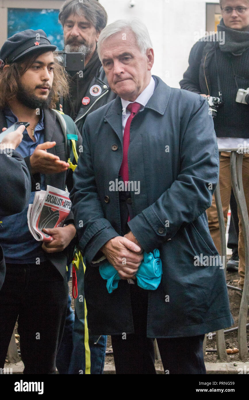 London UK 4th October 2018. Labour Shadow chancellor John McDonnell joins Staff Workers from McDonald's, JD Wetherspoon and TGI Fridays and UberEats riders organized by Unite Union  took part in a strike in Leicester Square  to  campaign for higher wages and to be paid  £10 an hour and an end to Zero Hour contracts Credit: amer ghazzal/Alamy Live News - Stock Image