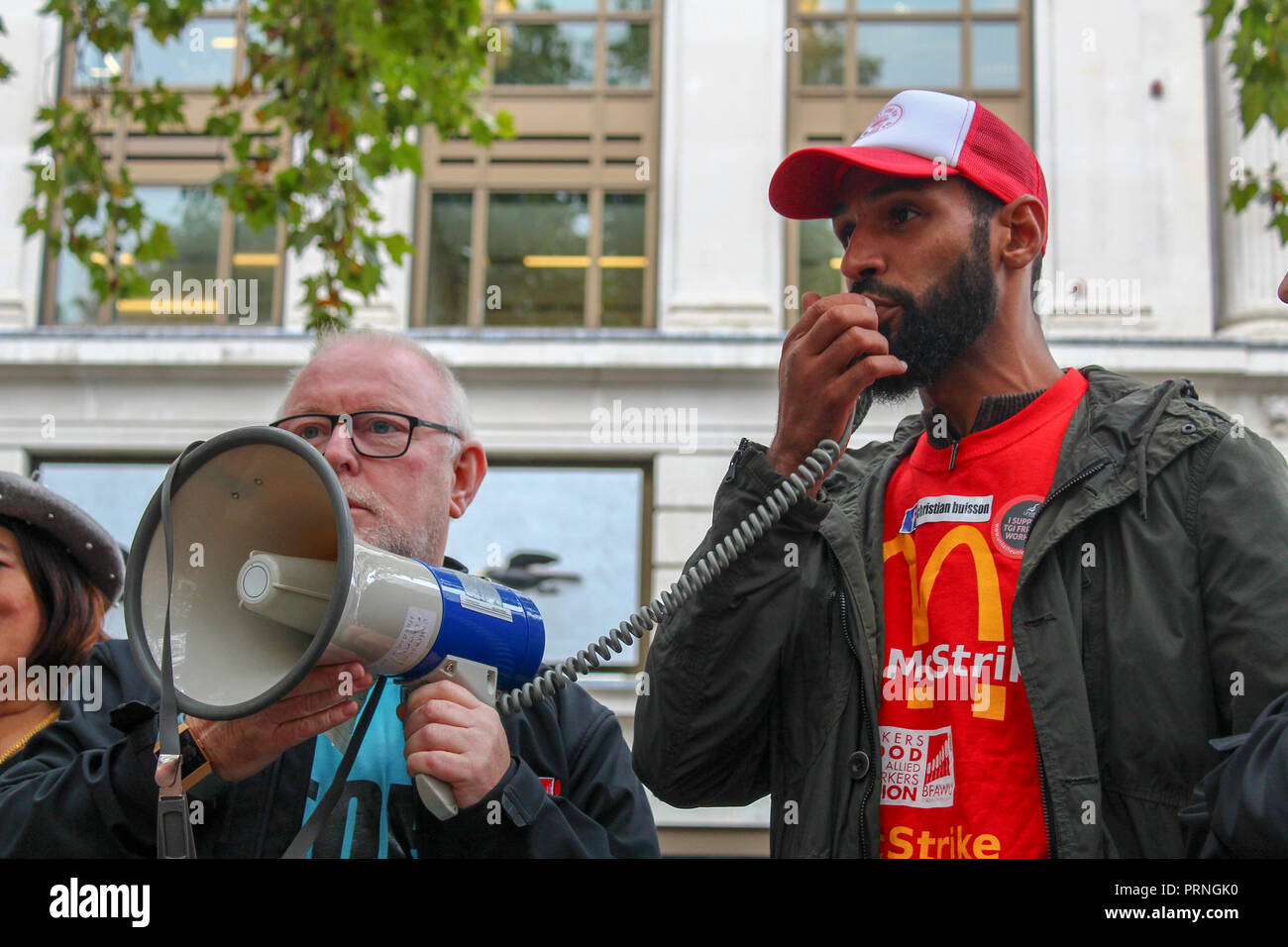 Leicester Square, London - 3rd October 2018. McDonald's, Wetherspoons, & TGI Friday workers take part in a co-ordinated strike, the first campaign of its kind, to highlight poor wage. Credit: Oliver Cole/Alamy Live News - Stock Image