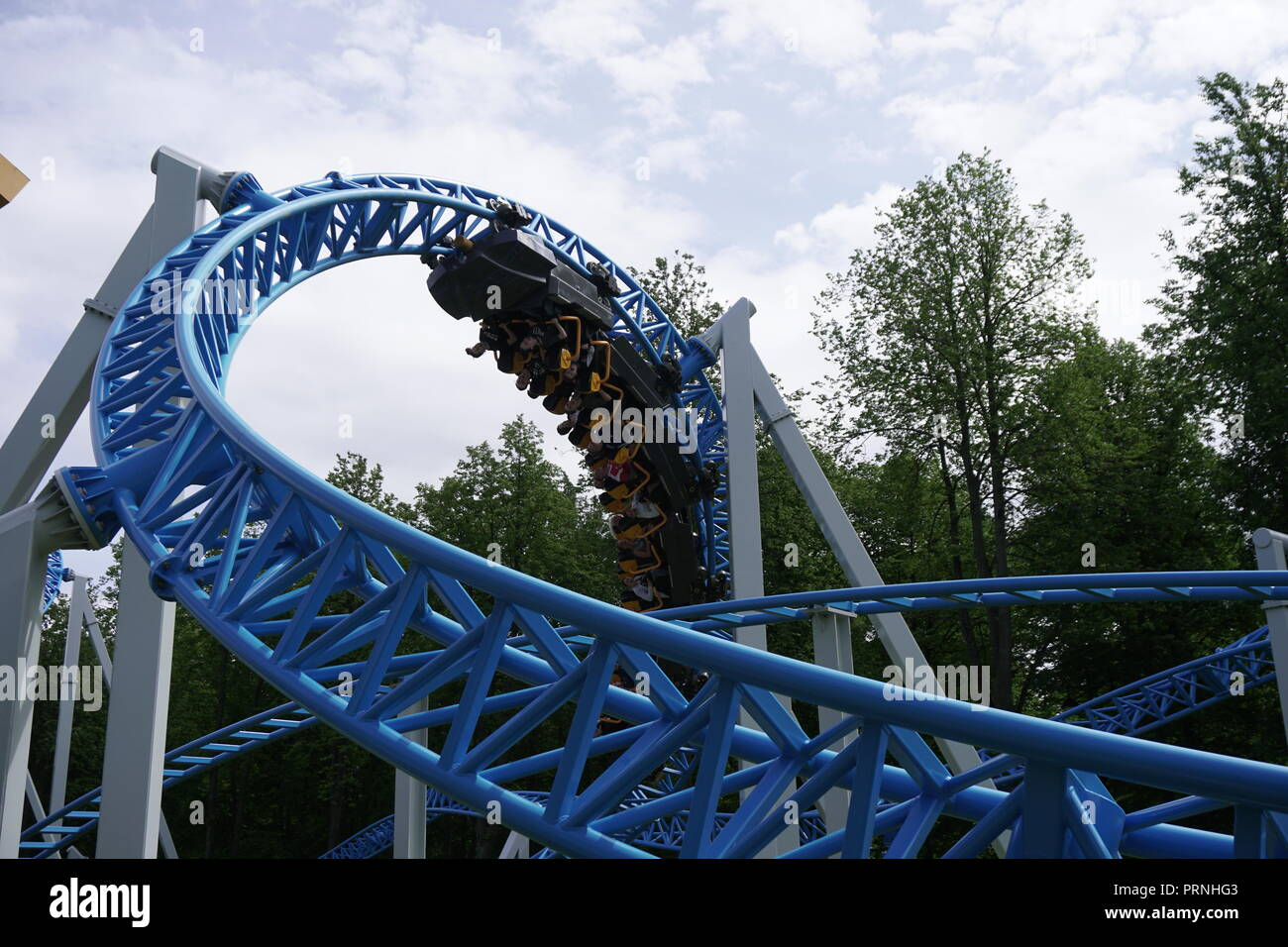 roller coaster attractions fun in the park for children - Stock Image