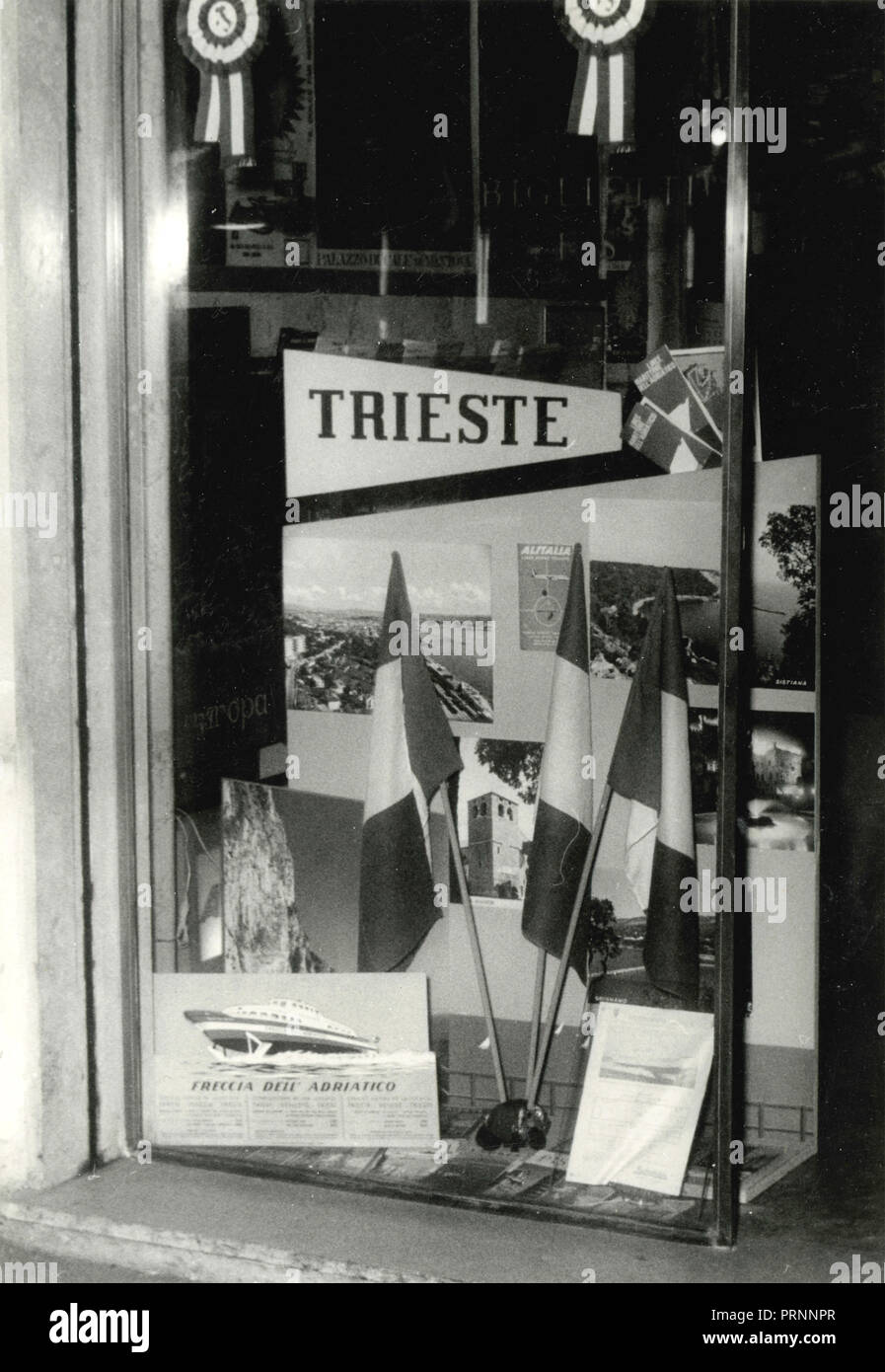 Travel agency advertising the city of Trieste, Italy 1960s - Stock Image