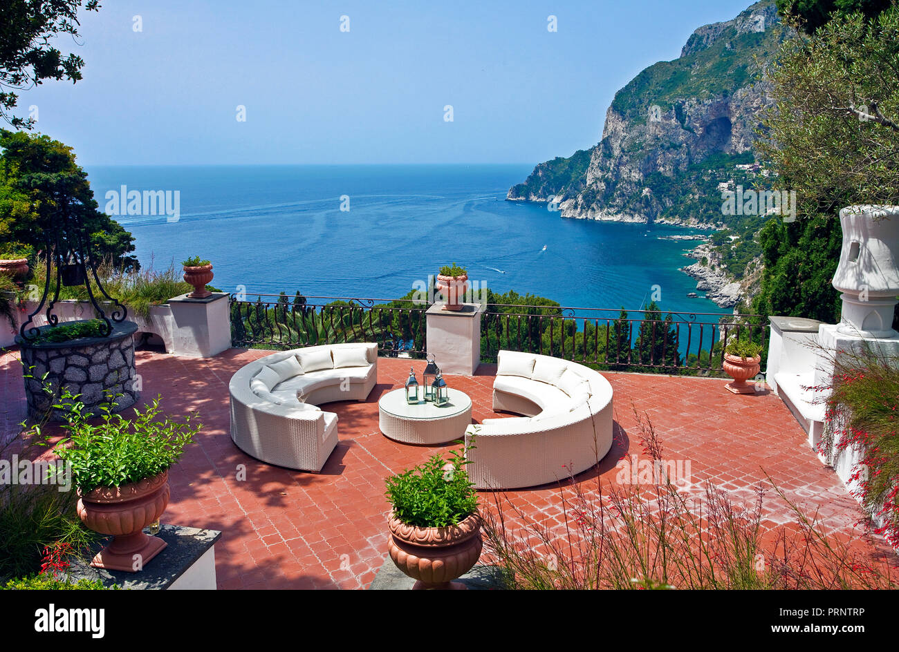 View from the terrasse of a luxury villa on the steep south coast of Capri island, Gulf of Naples, Campania, Italy - Stock Image