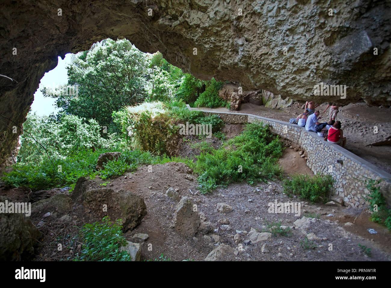 Hiker at the Grotta di Matermania, Capri, island, Gulf of Naples, Campania, Italy - Stock Image