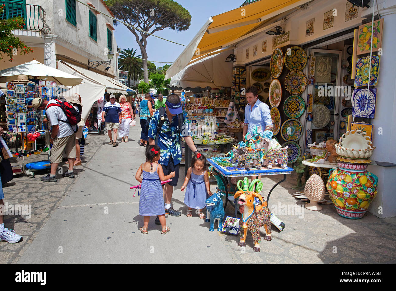 Tourists at souvenir shops, Anacapri, Capri island, Gulf of Naples, Campania, Italy - Stock Image