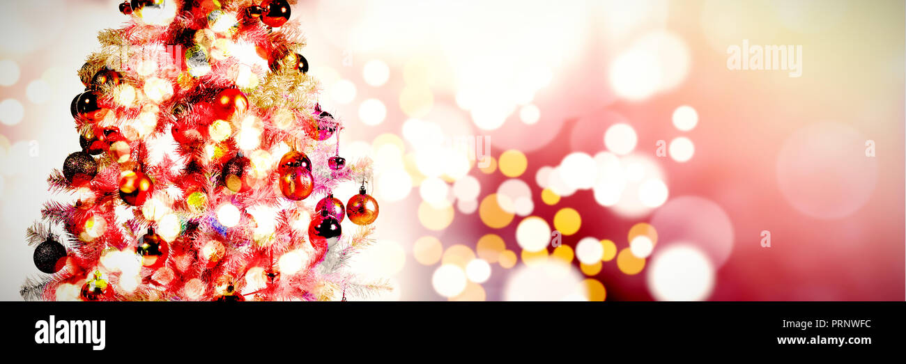 Composite image of shimmering christmas tree of lights - Stock Image