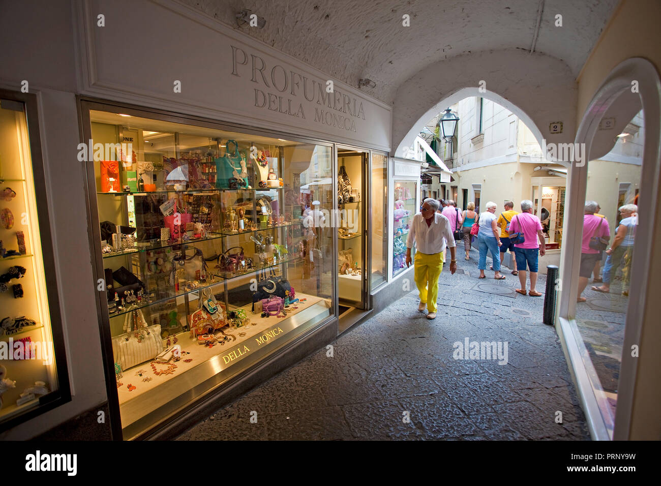 Luxury shops at a passage, old town of Capri island, Gulf of Naples ...