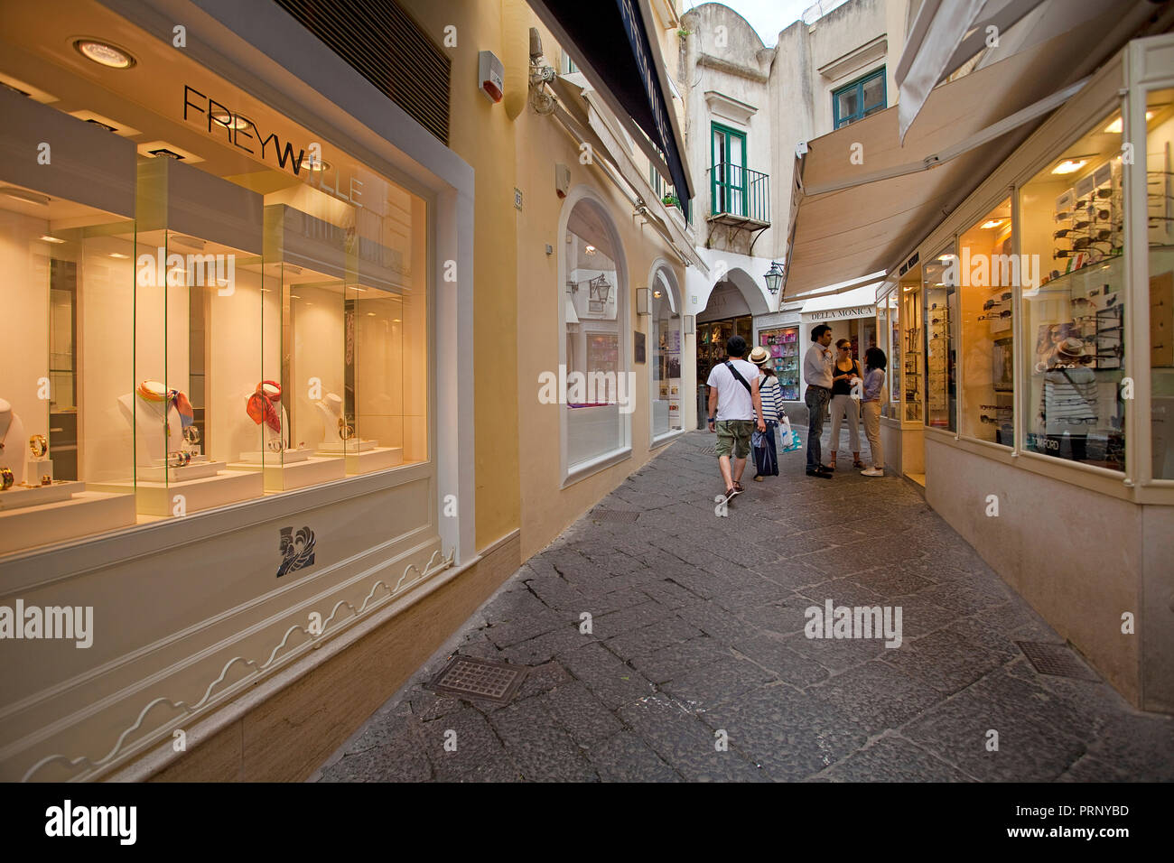 Luxury shops at a alley, old town of Capri island, Gulf of Naples, Campania, Italy - Stock Image