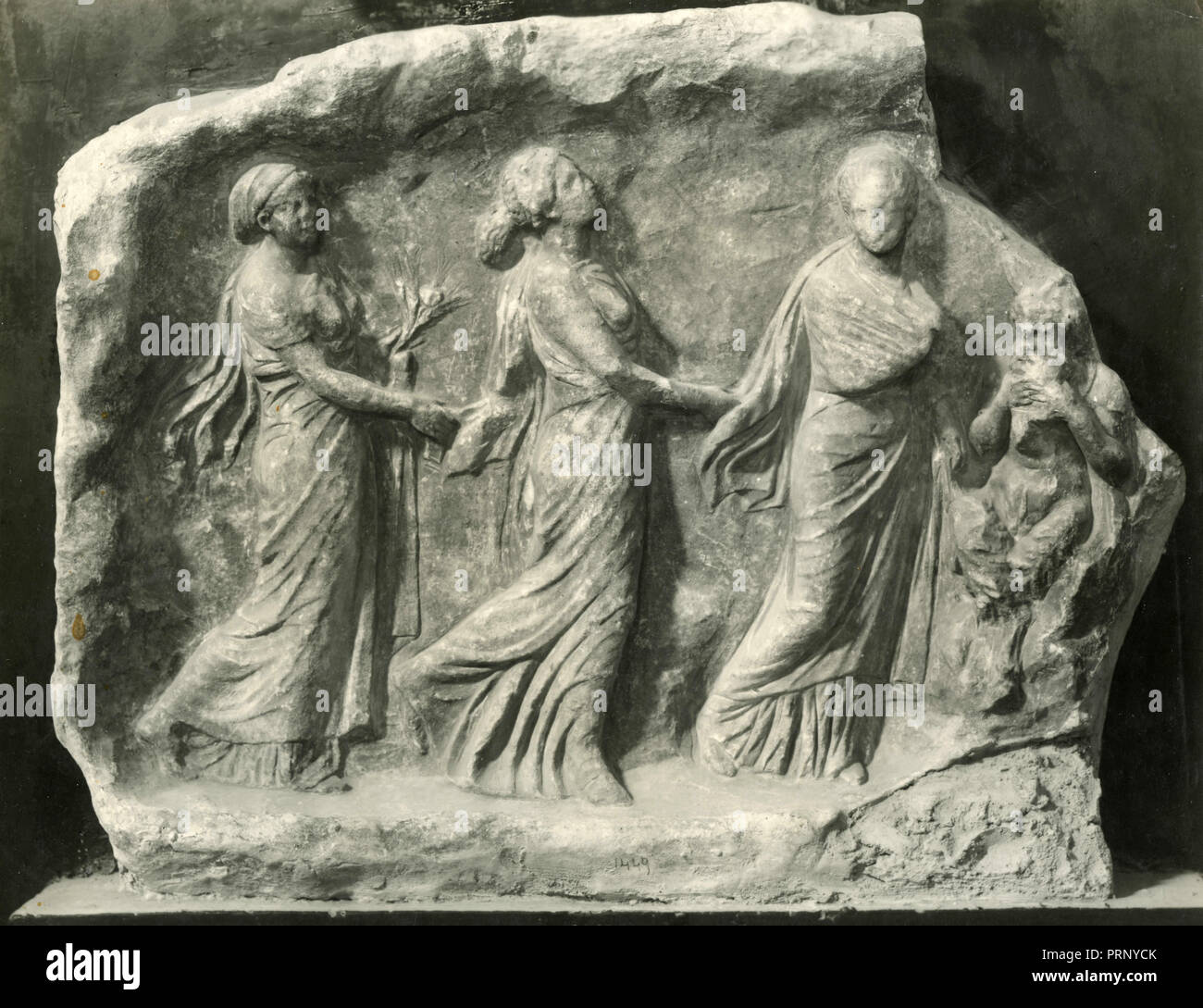 Marble votive relief to Pan with the three dancing Nymphs or Hours, Greece 1930s - Stock Image