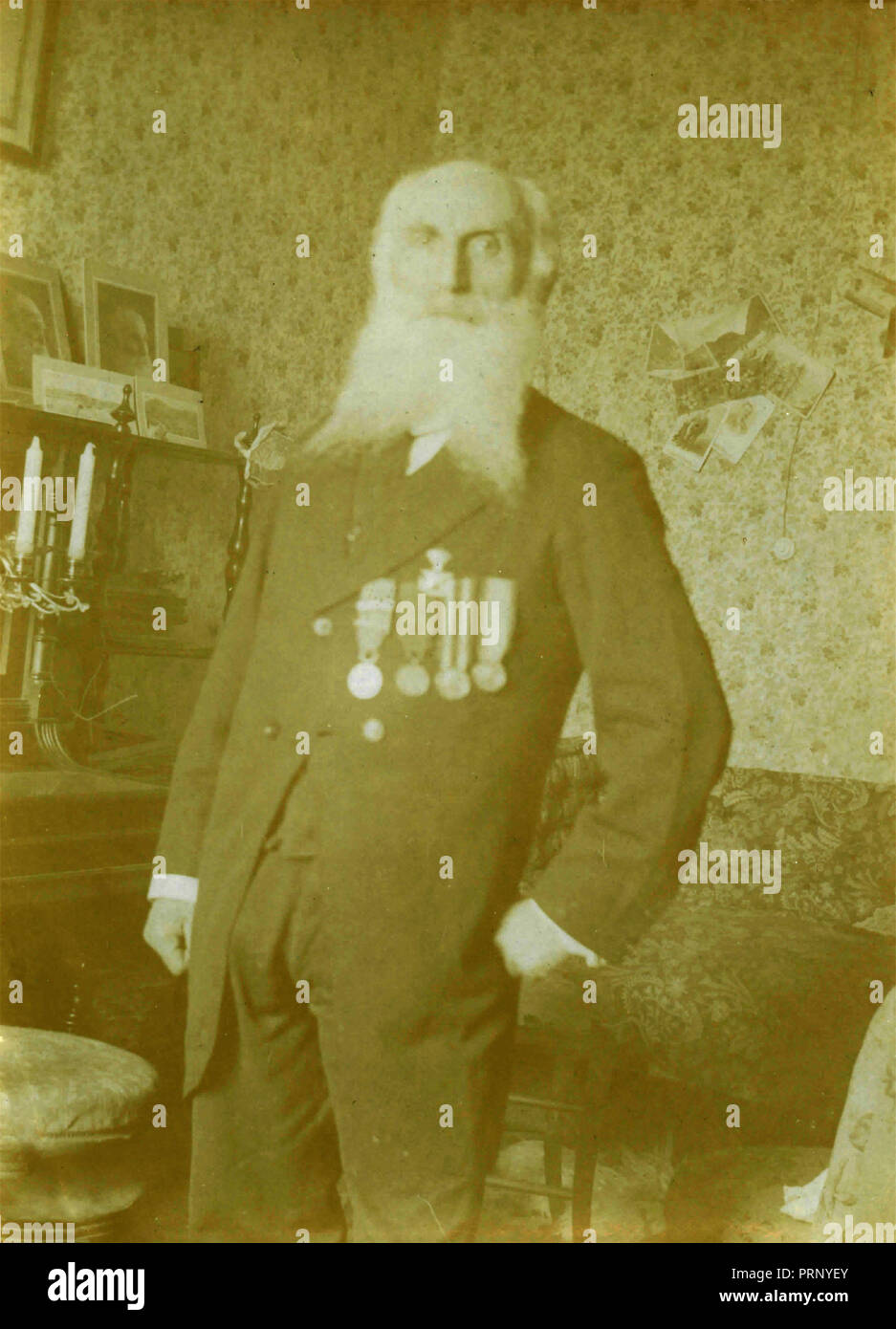 Veteran old man with long beard with awards and decoration, 1910s - Stock Image