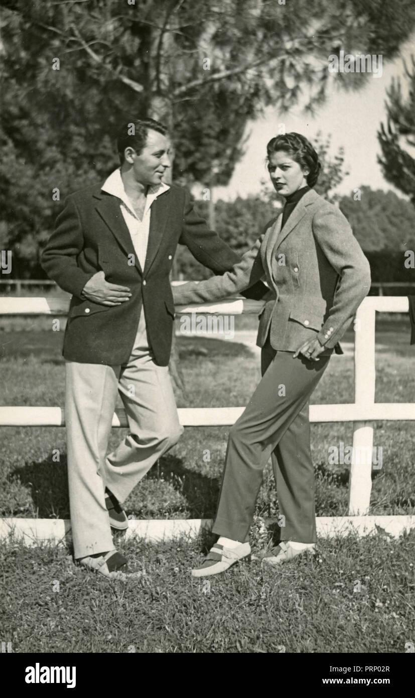 Brioni fashion couple models, Italy 1950s - Stock Image