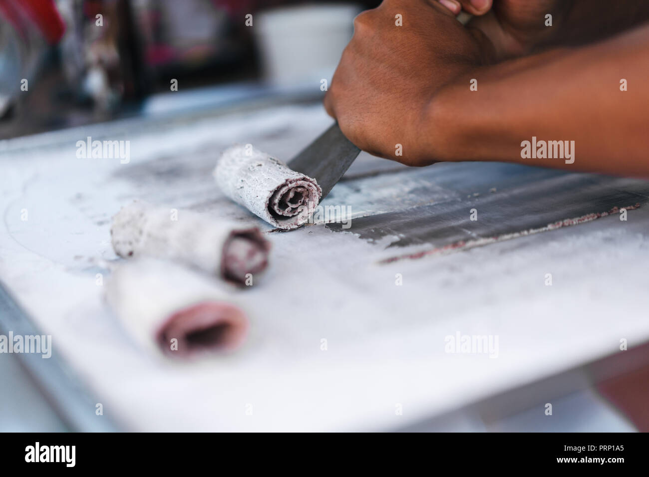 partial view of man cooking traditional sweet dessert - Stock Image
