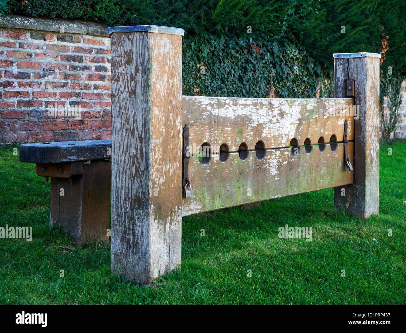 Stocks on the village green at Aldborough near Boroughbridge North Yorkshire England Stock Photo