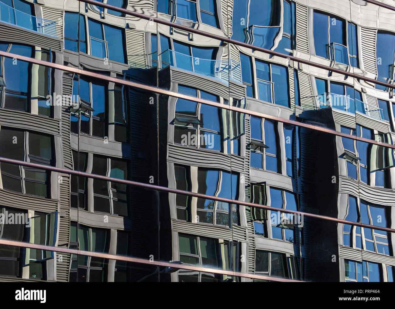 Warped reflection in downtown Seattle. - Stock Image