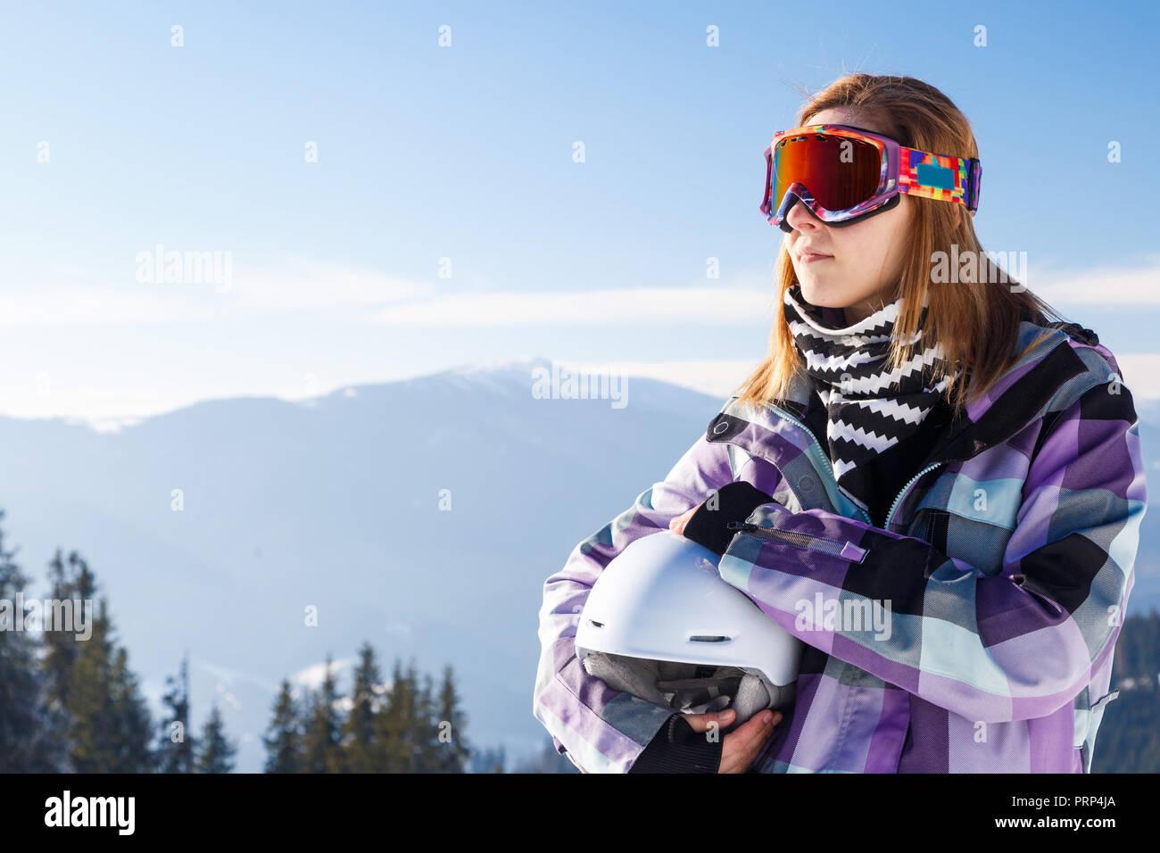 Skier girl on the background of high mountain Carpathians in Ukraine. Winter sport. - Stock Image