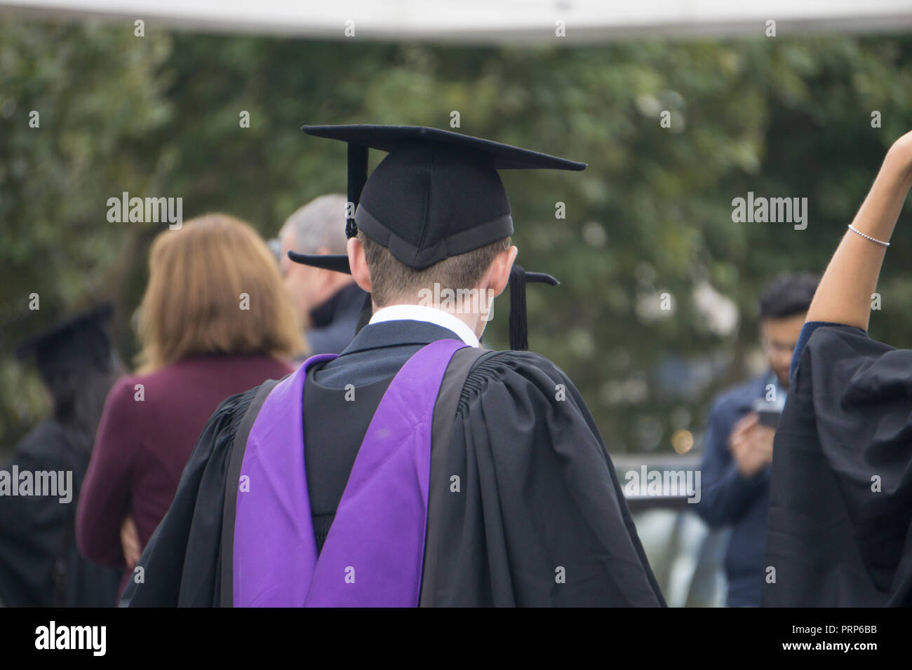 Student graduating with a university degree - Stock Image