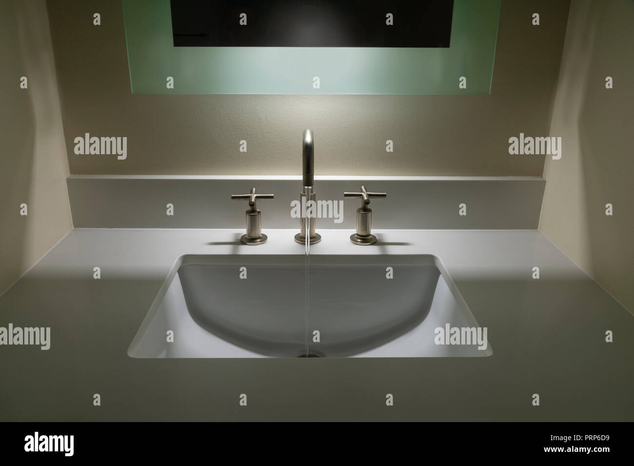Modern Bathroom Sink With Water Running - Stock Image